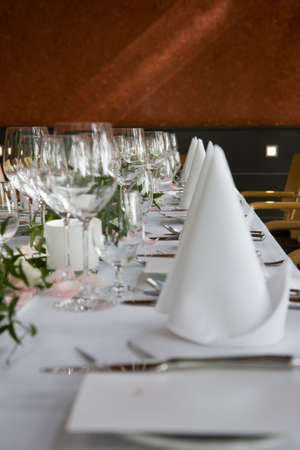 floridity: Well-laid table with white folded serviettes and wine glasses. Stock Photo