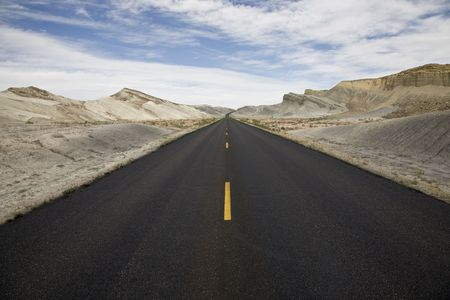 briar bush: Road through Desert landscape in fromt of Henry Mountains near Hanksville, Utah, USA Stock Photo