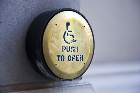 latchkey: Push to open button for handicapped people Stock Photo