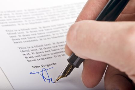 Signing a letter with a fountain pen photo