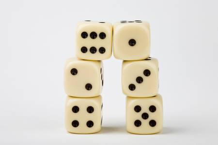 towering: Dice towering on white background Stock Photo