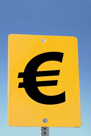 Euro Sign on a yellow road sign and blue sky photo
