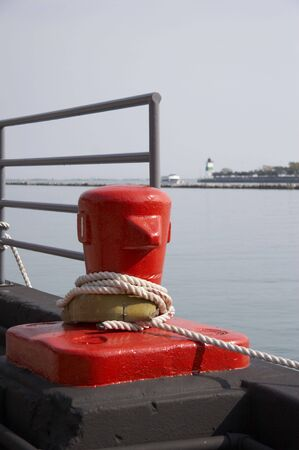 bollards: Red Mooring bollards, Lake Michigan in background Stock Photo