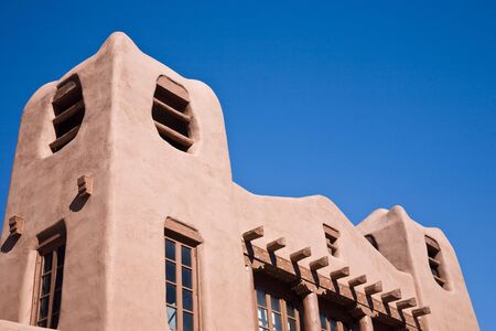 adobe pueblo: Adobe style building, Santa Fe in New Mexico, USA, blue sky Stock Photo