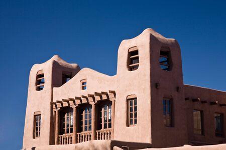 Adobe style building, Santa Fe in New Mexico, USA, blue sky photo