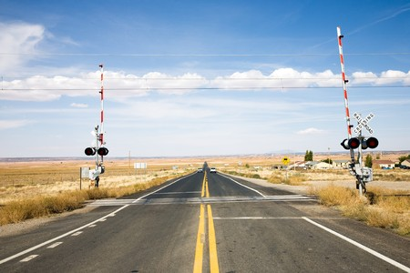 levels: Railroad crossing with gates in New Mexico, USA