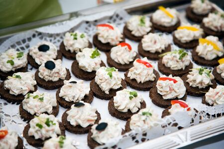 aliment: Black bread canape with cream cheese