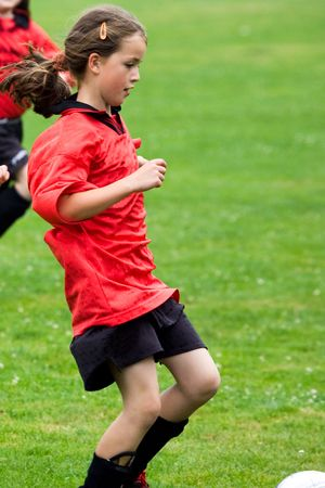 10 years girls: Young girl playing soccer Stock Photo