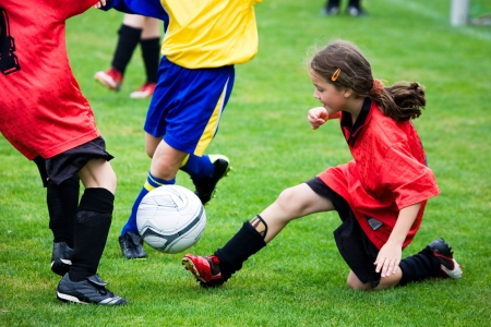 soccer pitch: Young girl playing soccer Stock Photo