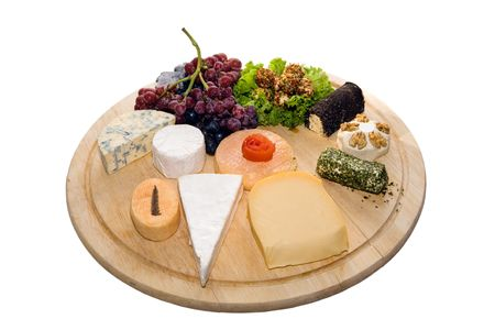 Cheese platter with bunch of grapes photo