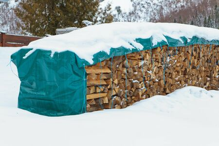 firewood in snow Stock Photo - 12730755