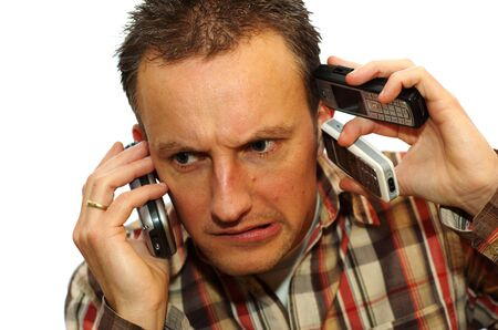 Busy businessman with 3 cell phones getting answers Stock Photo - 4083135