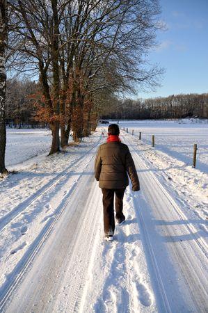 Senior female strawling through the snow