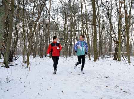 Couple running and talking in snowy scene photo