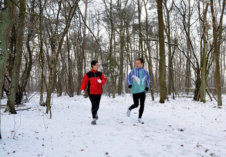Family members running in the winter photo