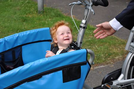 Child in carrier bicycle says goodbye to daddy Stock Photo - 5152853