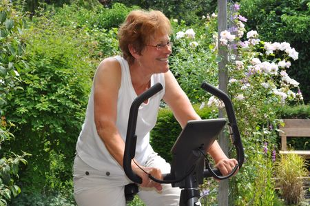 hometrainer: Senior woman excercising on a hometrainer