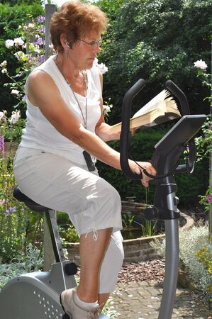 music therapy: Workout on the hometrainer after surgery Stock Photo