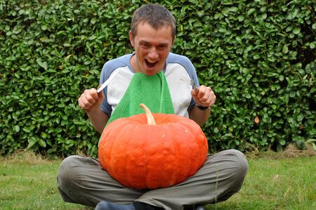Young man enthousiastic about his pumpkin meal