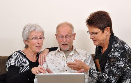 Seniors man and women exploring the web