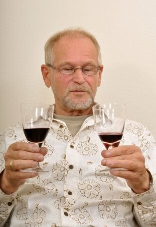 Senior man having a good time with friends Stock Photo