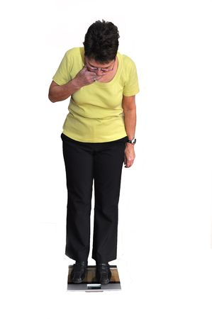 Senior woman surprised by her low  weight