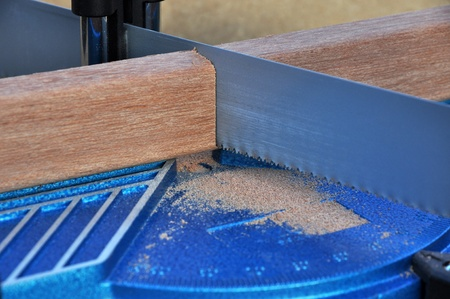 miter: Sawing wood manually with a miter saw Stock Photo
