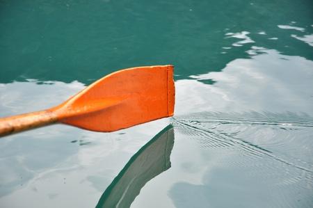 Rowing oar dripping water