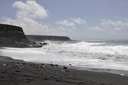 Black beach and surf at Ajuy on Fuerteventura