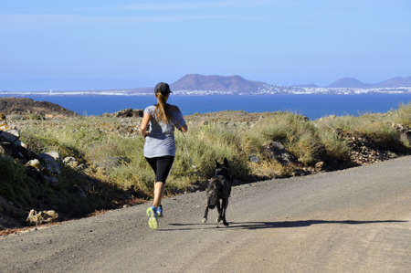Running with the dog alongside the coast