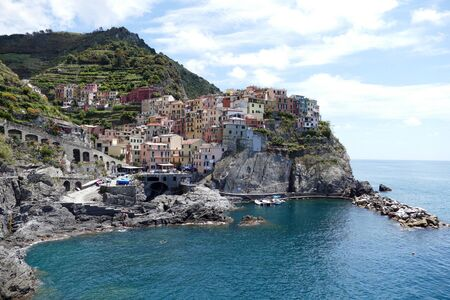 Manarola Manaea in the local dialect is a small town, a frazione of the comune municipality of Riomaggiore, in the province of La Spezia, Liguria, northern Italy. It is the second smallest of the famous Cinque Terre towns frequented by tourists. Stock Photo