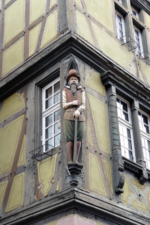 Wooden statue at a house in Colmar, Elzas, France