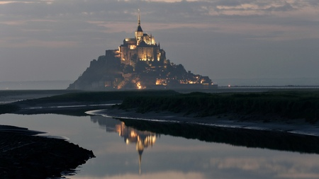 Mont saint michel Illuminated at Dusk in Summer at Low Tide