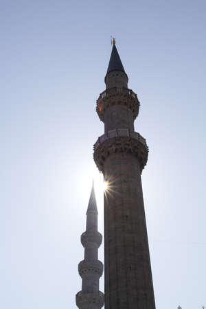 minaret against sun