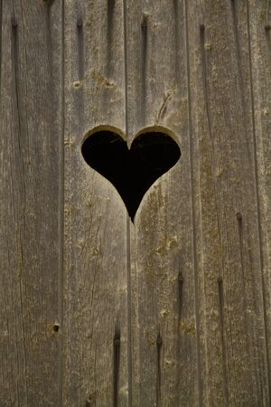 one heart in wood Stock Photo