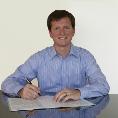 Signing document with blue shirt