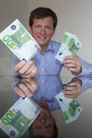 Giving 100 Euro (vertical) Stock Photo