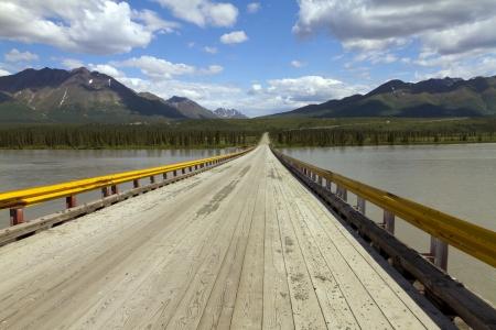 wooden bridge over river Reklamní fotografie