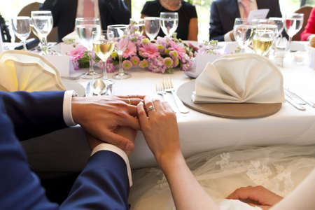 hands married couple on table