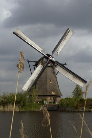 one windmill with dark clouds