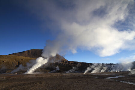 sun playing with the steam at El Tatio Geyser Chile Stock Photo