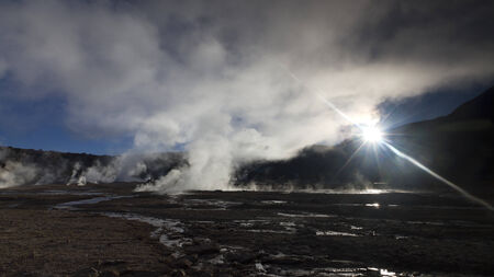 sun shining to the steam in the El Tatio Geyser Chile Stock Photo