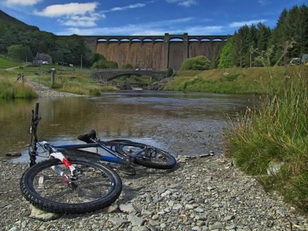 elan: Biking at the Claerwen Dam Stock Photo