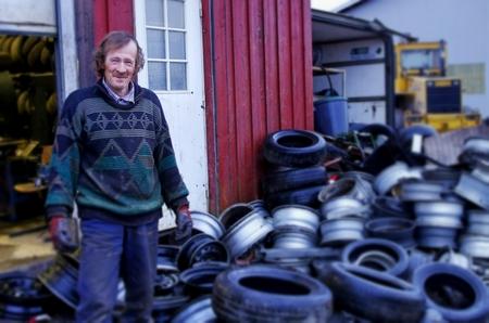 man at car scrapyard Editorial