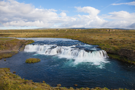 salmon migration: Faxi waterfall in Iceland with a fish ladder for salmon on the left