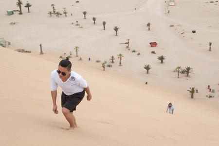 Young Filipino climbs Dune 7, Walvis Bay, Namibia