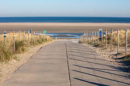 Walkway to the beach with guerrilla knitting Standard-Bild