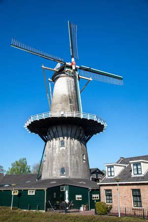 Traditional dutch windmill in the town of Wateringen, Westland, The Netherlands