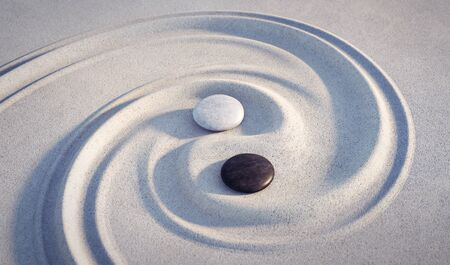 Yin Yang motif - stones in the sand 版權商用圖片