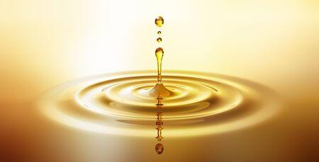 Druppel gouden olie Stockfoto